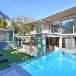 Exterior beyond pool towards house