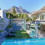 4 Views of house summer house & bar from beyond pool